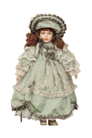 Doll in a beautiful dress on a white background photo