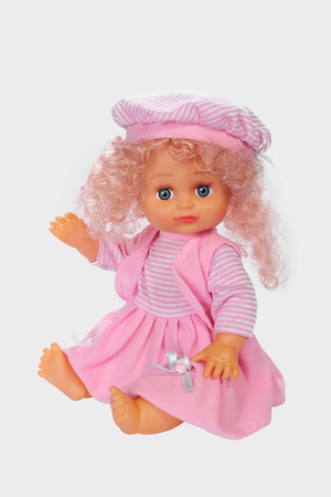 The doll waving a hand on a white background
