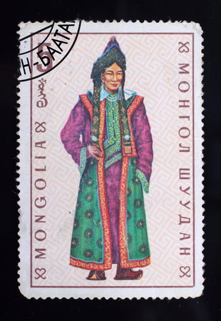 Mongolia - circa 1969: A post stamp printed in the Mongolian shows image of clothes, series Mongolian national clothes, circa 1969.