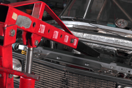 auto hoist: The automobile hydraulic elevator lifts the repaired car.