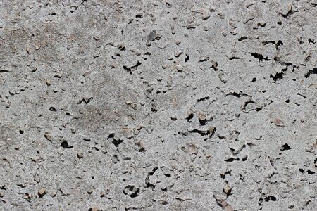 fraction: Closeup of gray granular concrete of large fraction