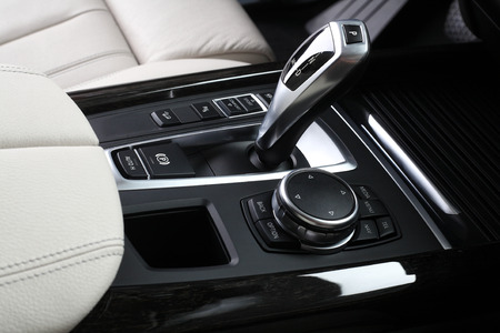 silver sports car: Interior of leather passenger compartment of the car in light tones. Stock Photo