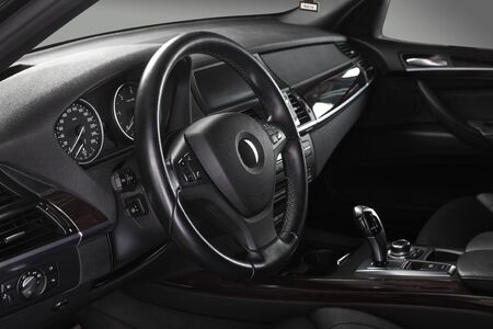 domestic car: Interior of leather passenger compartment of the car in dark tones. Stock Photo