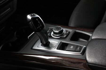 compartment: Interior of leather passenger compartment of the car in dark tones. Stock Photo