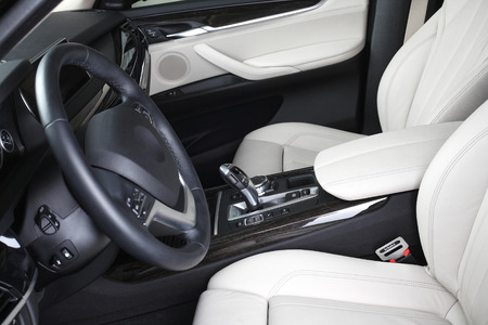 compartment: Interior of leather passenger compartment of the car in light-dark tones.