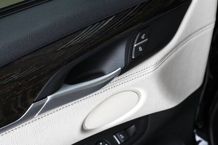 compartment: Interior of leather passenger compartment of the car in light tones. Stock Photo