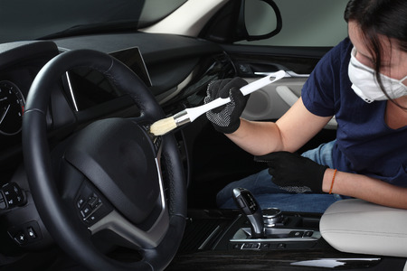 cleaning hands: Cleaning of interior by a soft brush. Stock Photo