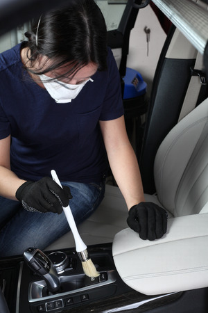 Cleaning of interior by a soft brush. Stock Photo
