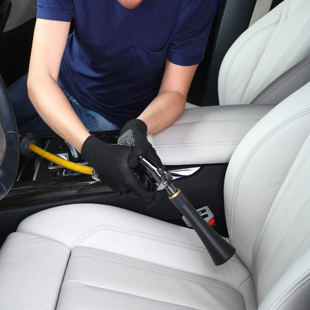 clean car: Cleaning of  interior of the car hot steam