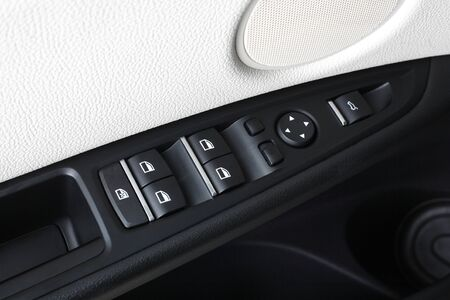 compartment: Interior of leather passenger compartment of the car in light tones. Control button