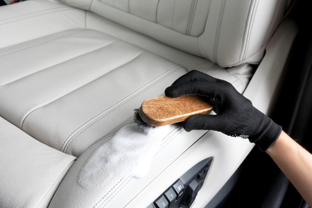 Washing of interior by a soft brush with foam.