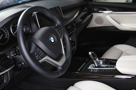 compartment: BMW X5. Interior of leather passenger compartment of the car in light-dark tones. 04.10.2015. Moscow.