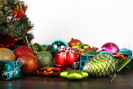 fir cones: Christmas and New year set. Spheres, fir cones and decorations under a fir-tree.