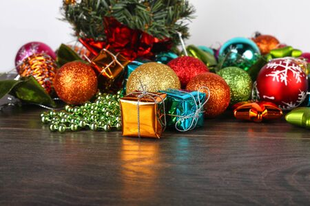 fir cones: Christmas and New year set. Spheres, fir cones and decorations under a fir-tree on a wooden background. Stock Photo