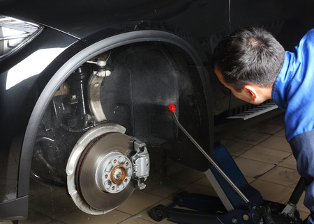 service car: Car service. The worker washing of the car under a high pressure.