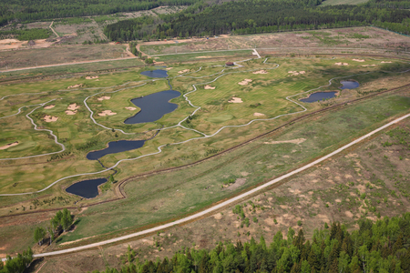 reservoirs: Aerial Views - Russia. Golf club - golf courses, paths, reservoirs. Shooting from the helicopter.