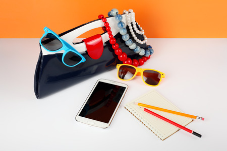 Womens Fashion Accessories. Your style - sunglasses, handbag, phone and notebook are decorated with a beads and a pearl necklace.