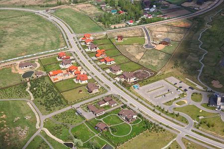 reservoirs: Aerial Views - Russia. Golf club - parking, golf courses, paths, cars, reservoirs. Shooting from the helicopter.