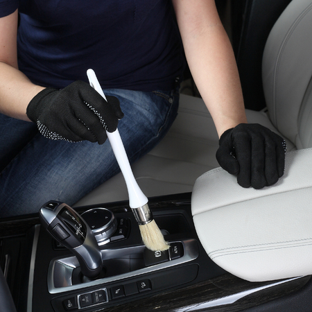 rag wheel: Cleaning of interior by a soft brush. Stock Photo