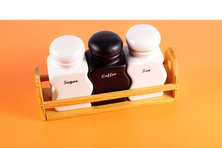 capacities: Capacities for condiment spices - Sugar, coffee, tea a set on a orange background.