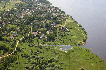 the volga river: Aerial Views - Russia. Houses, moorings and other constructions on the river bank Volga. Shooting from the helicopter.