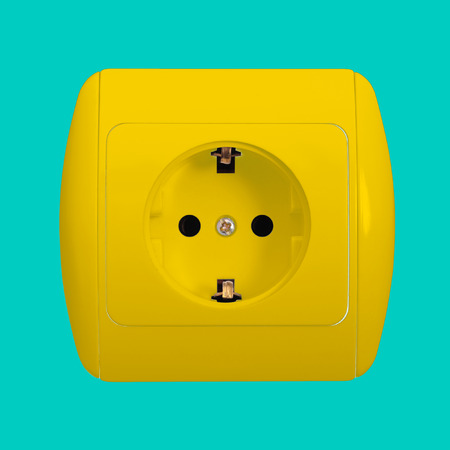grounding: The yellow electric socket with grounding on a blue background Stock Photo