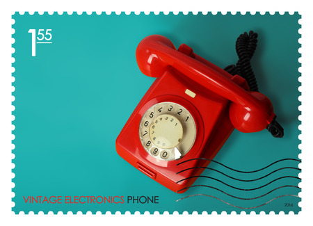 A fake post stamp shows image of retro phone, Fake series Vintage electronics.