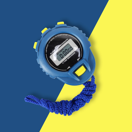 Sports equipment - Blue Digital electronic Stopwatch on a on yellow-blue background Stock Photo