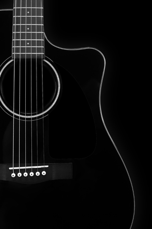 Musical instrument - Silhouette of a black acoustic guitar with cutaway on a black background. Stock Photo