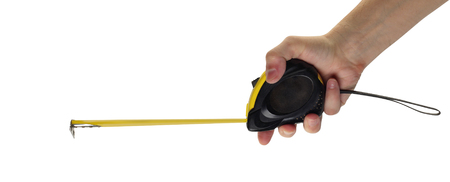 Objects hands action - Self-retracting metal tape measure  worker hand isolated white background. Stock Photo