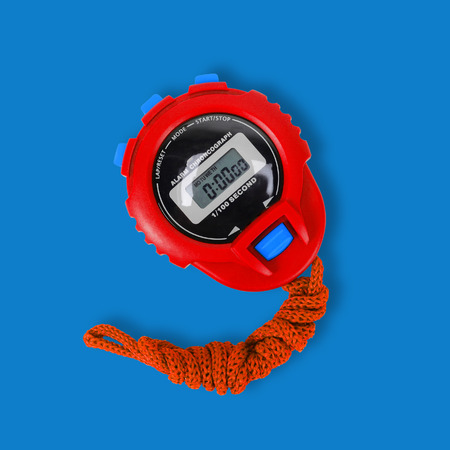 Sports equipment - Red Digital electronic Stopwatch on a blue background. Stock Photo