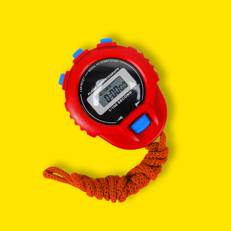Sports equipment - Red Digital electronic Stopwatch on a yellow background.