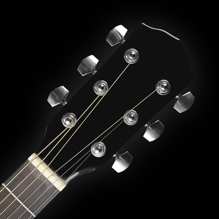 Musical instrument - headstock peghead black acoustic guitar on a black background.