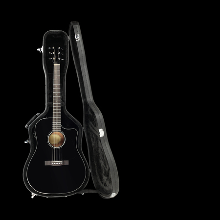 Musical instrument - Acoustic guitar hard case isolated on a black background.