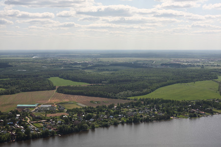 Aerial Views - Russia. Houses, moorings and other constructions on the river bank Volga. Shooting from the helicopter.