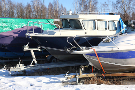 Winter boats parking - boats on a trailers