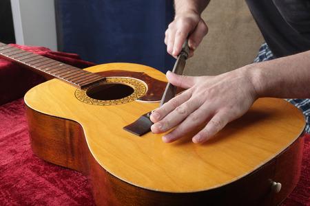 Musical instrument guitar repair and service - Grinding bridge nut.