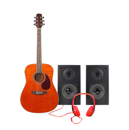Music and sound - Front view orange acoustic guitar, line array loudspeaker enclosure cabinet and red headphone isolated on a white background. Stock Photo