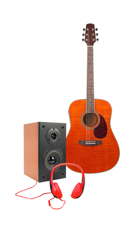 Music and sound - Front view Orange flame maple acoustic guitar, line array loudspeaker enclosure cabinet and red headphone isolated on a white background.
