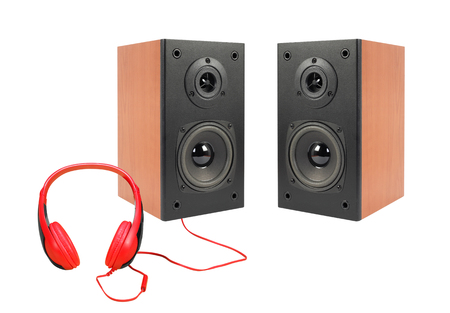 Music and sound - Front view line array loudspeaker enclosure cabinet and red headphone isolated on a white background. Stock Photo