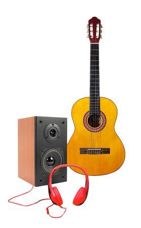 Music and sound - Front view Yellow classic acoustic guitar, line array loudspeaker enclosure cabinet and red headphone isolated on a white background. Stock Photo