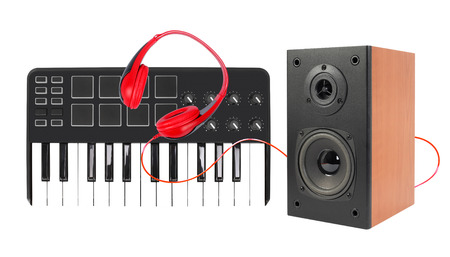 Music and sound - line array loudspeaker enclosure cabinet, MIDI keyboard and red headphone isolated on a white background.
