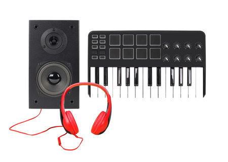 Music and sound - Front view line array loudspeaker enclosure cabinet, MIDI keyboard and red headphone isolated on a white background.