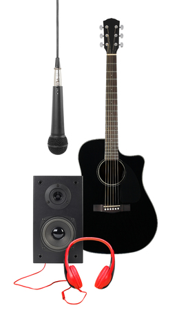 Music and sound - Front view black acoustic guitar, microphone, line array loudspeaker enclosure cabinet and red headphone isolated on a white background.