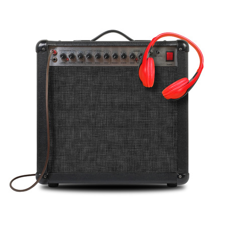 Music and sound - Musical instrument Guitar amplifier,  headphone and cable front view isolated on a white background.