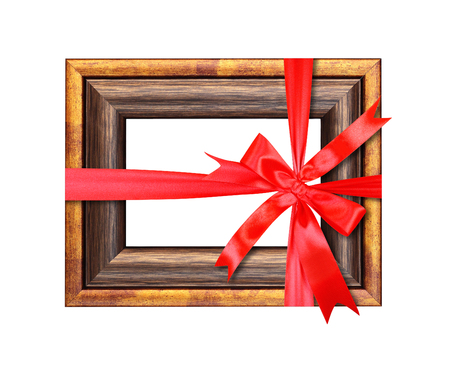 Vintage gilded frame for photos gift tied red bow. It is isolated, the worker of paths is present.