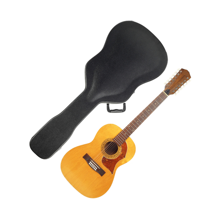 Musical instrument - Vintage twelve-string acoustic guitar hard case on a white background.