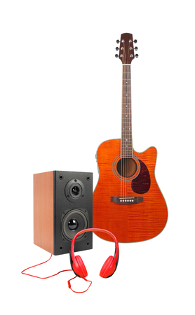 Music and sound - Front view Orange flame maple electro acoustic cutaway guitar, line array loudspeaker enclosure cabinet and red headphone isolated on a white background. Stock Photo