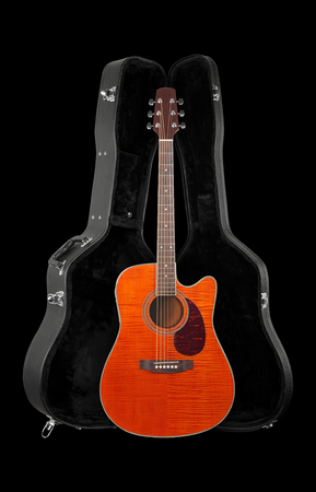 Musical instrument - Front view orange electro acoustic cutaway guitar in hard case  isolated on a black background.