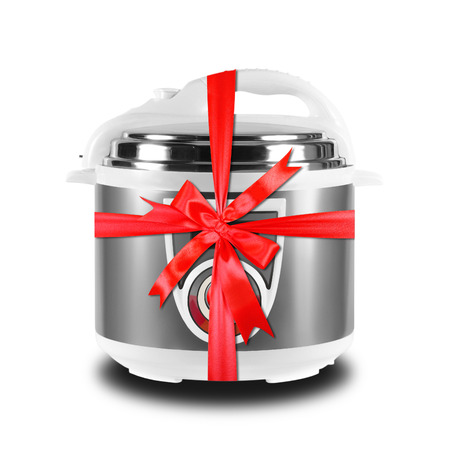 Home appliance - Multicooker pressure cooking gift tied red bow on a white background. It is isolated, the worker of paths is present.